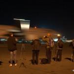 Участники споттинга на фоне самолета